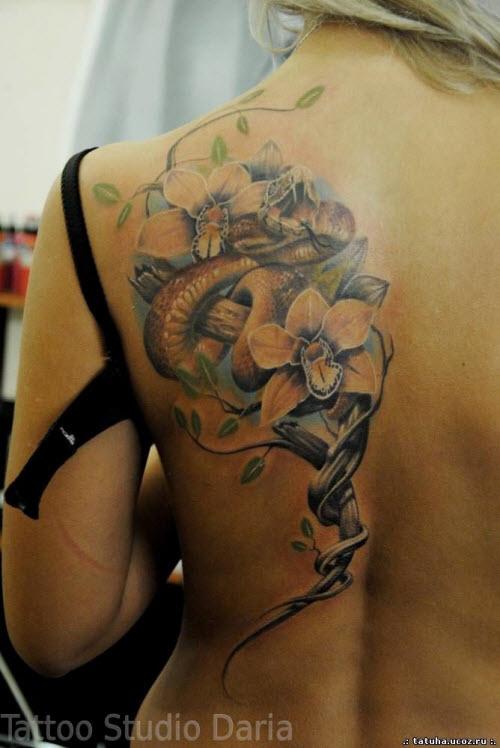 Фото женских тату со змеями - 8