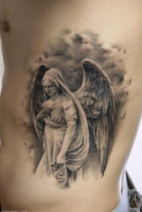Фото тату ангела на животе - 1