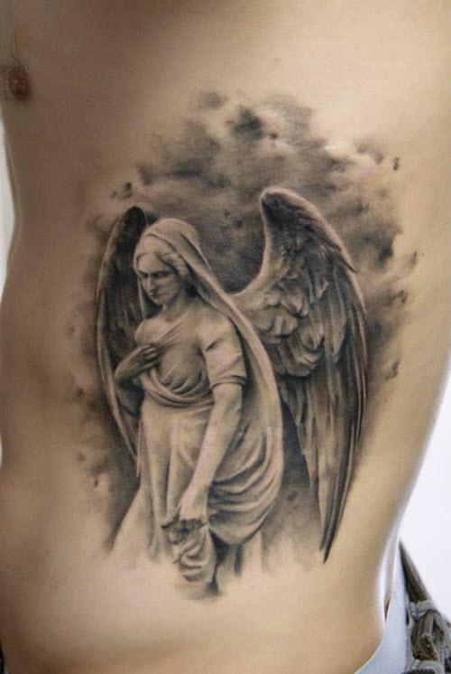 Фото тату с ангелами на груди - 0