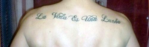 Фото тату с надписями на спине - 8