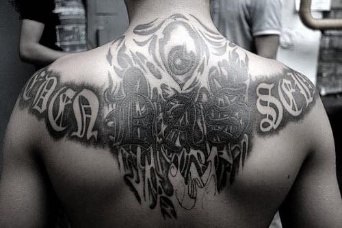 Фото тату с надписями на спине - 9