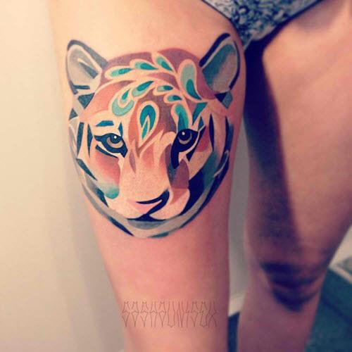 Фото тату тигра на бедре