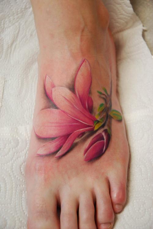 Женская тату цветок на ноге фото - 9
