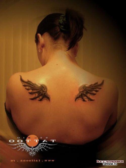 Женские тату на спине крылья фото - 8