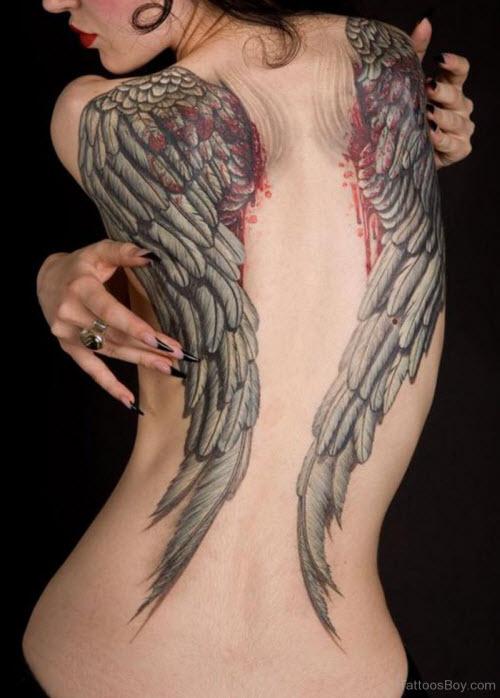 Лучшие женские тату на пояснице фото - 8