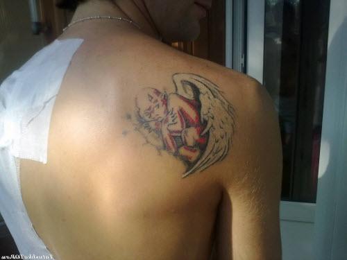 Маленькие женские тату на лопатке фото - 2