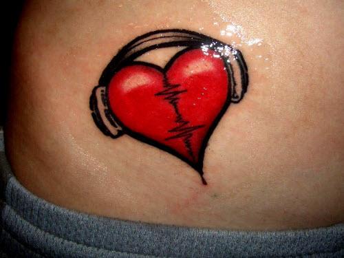 Сердце на животе фото тату - 2