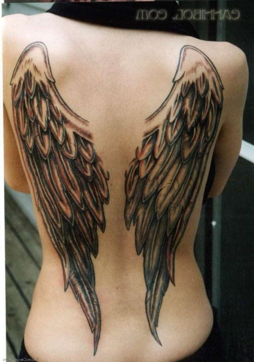 Тату ангел на спине девушки фото - 2