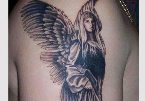 Тату ангел на спине девушки фото - 3