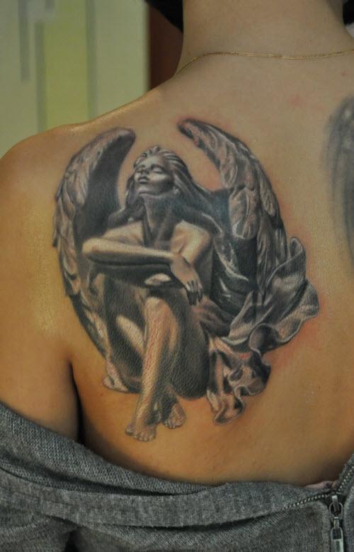 Тату ангел на спине девушки фото - 4