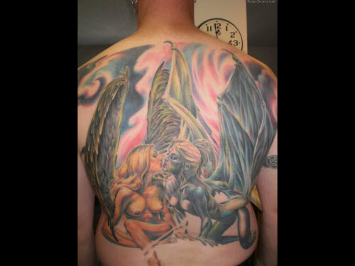 Тату ангел на спине девушки фото - 6