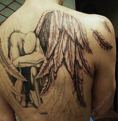 Тату ангела хранителя на спине фото - 4