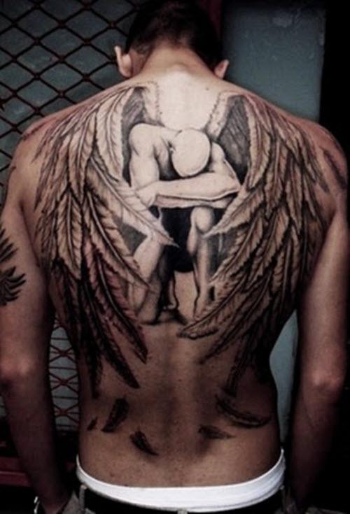 Тату ангела хранителя на спине фото - 9