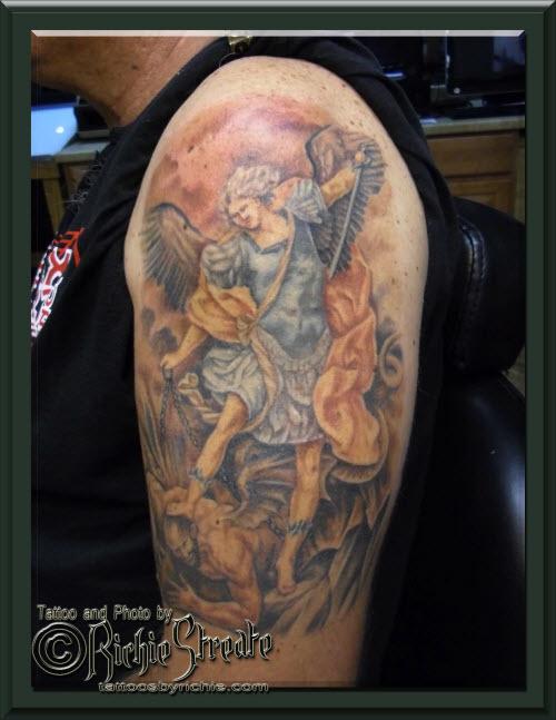 Тату архангела михаила на спине фото - 0