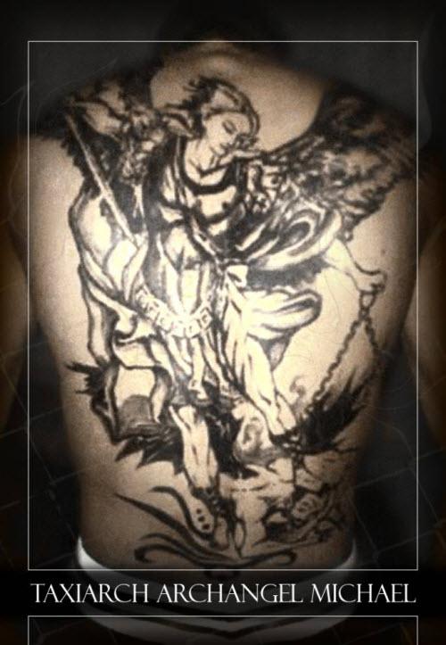 Тату архангела михаила на спине фото - 1