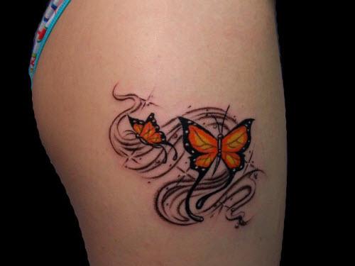 Тату бабочек на бедре фото - 5