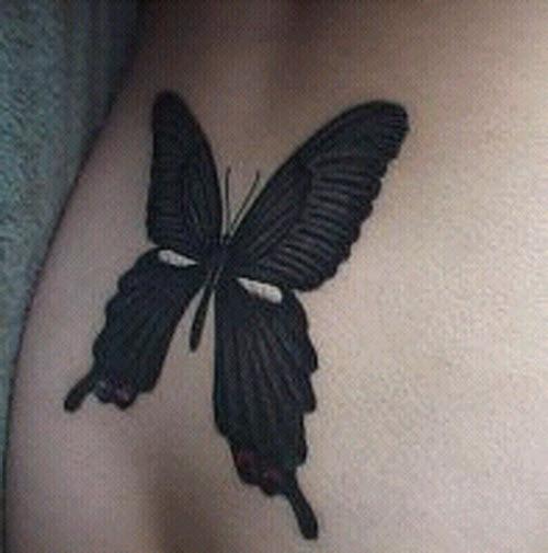 Тату бабочка на копчике фото - 4