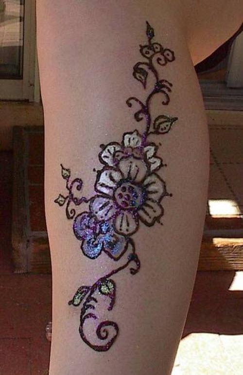 Тату хной цветы на ногах фото - 9