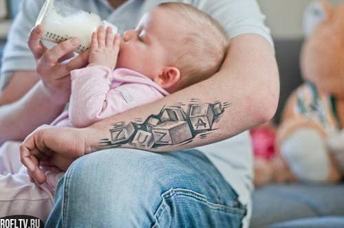 Тату имени ребенка на шее фото - 7