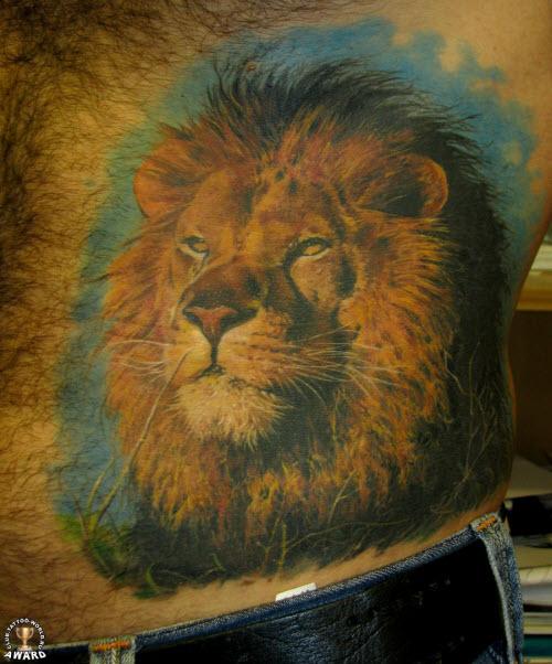 Тату льва на животе фото - 7