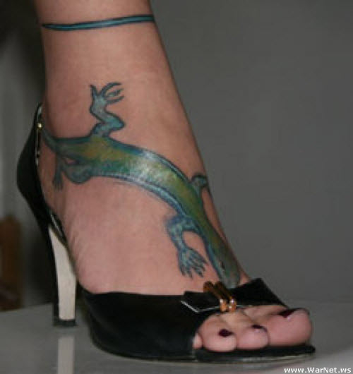 Тату на ноге у девушки фото - 2