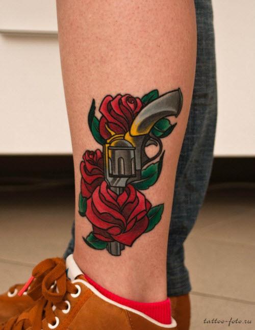 Тату на пистолет на ноге фото - 2