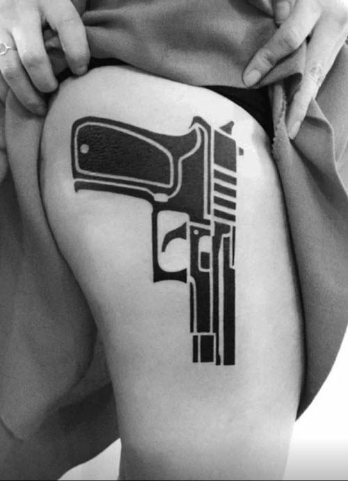 Тату на пистолет на ноге фото - 9
