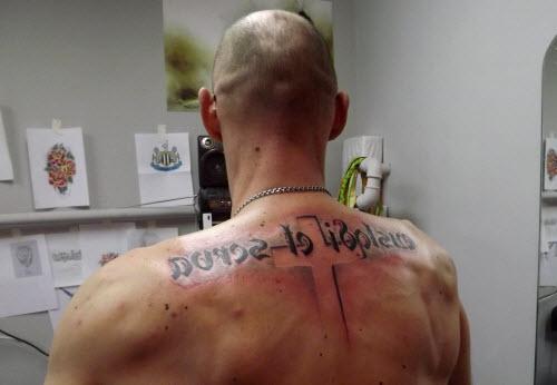 Тату на спине я русский фото - 4