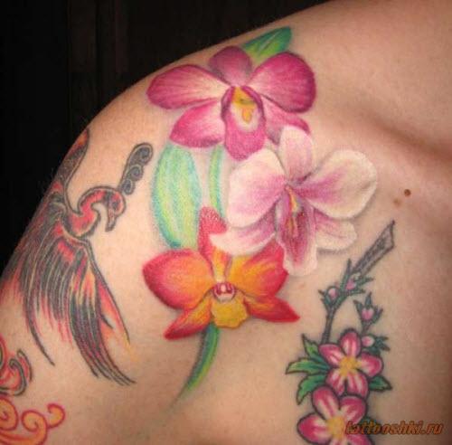 Тату орхидеи на лопатке фото - 7