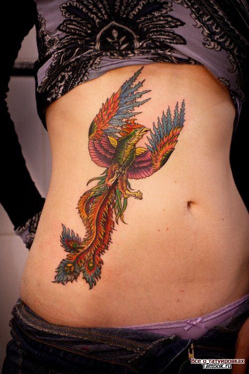 Тату птица феникс на животе фото - 8