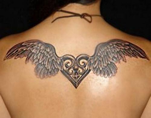Тату сердце с крыльями на пояснице фото - 4